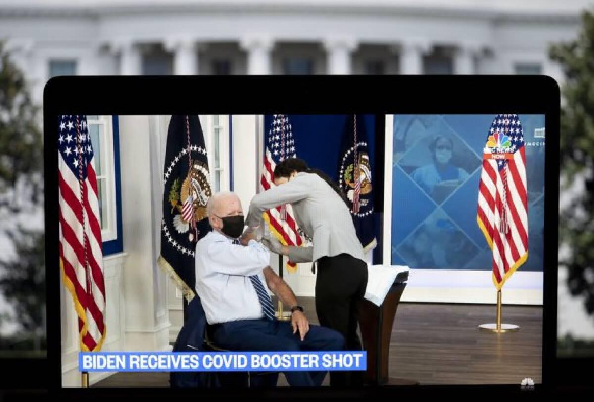 U.S. President Joe Biden is seen on a screen as he receives his COVID-19 vaccine booster shot in Washington, D.C., the United States, on Sept. 27, 2021. (Xinhua/Liu Jie)