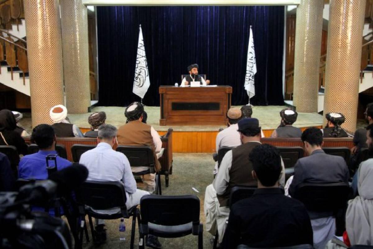 Taliban spokesman Zabihullah Mujahid (Rear) speaks during a press conference in Kabul, Afghanistan, on Sept. 7, 2021.