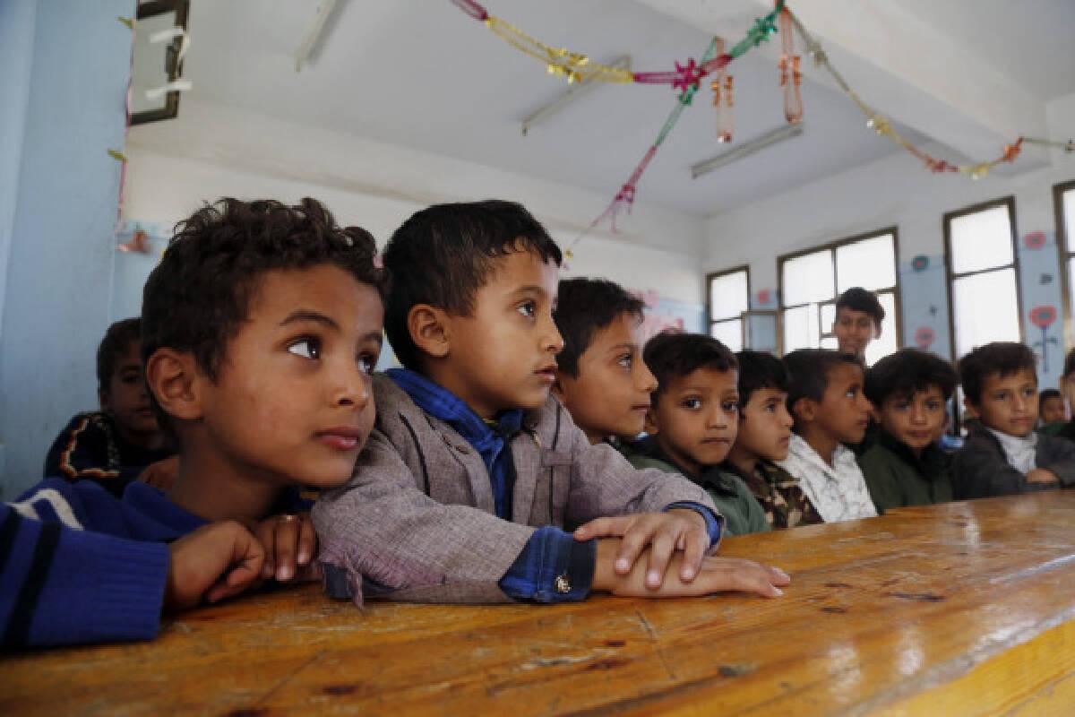 School children attend Arabic class at a school in Sanaa, Yemen on Sept. 8, 2021.
