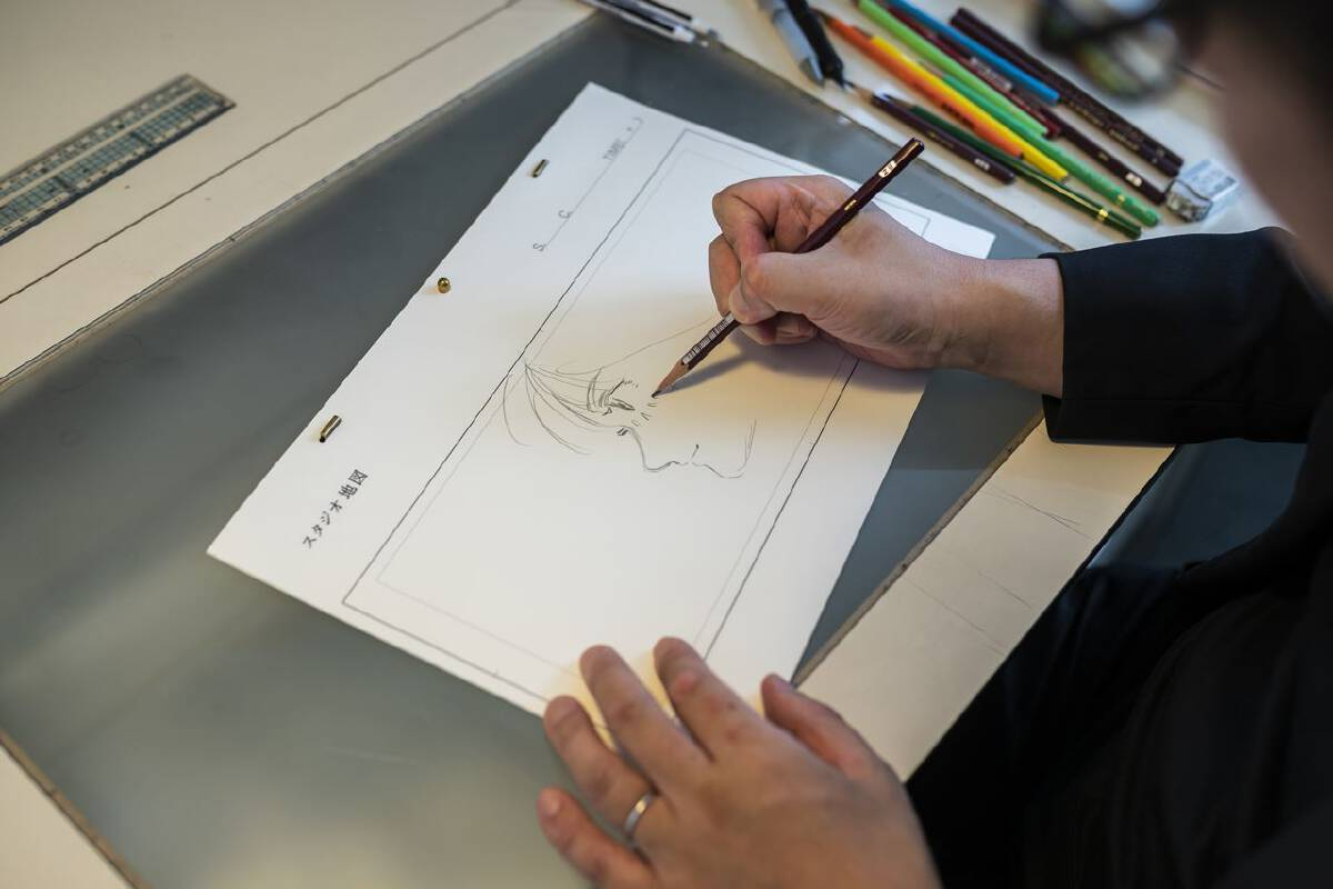Mamoru Hosoda draws at his office in Studio Chizu in Tokyo on Sept. 9. MUST CREDIT: photo for The Washington Post by Shiho Fukada.