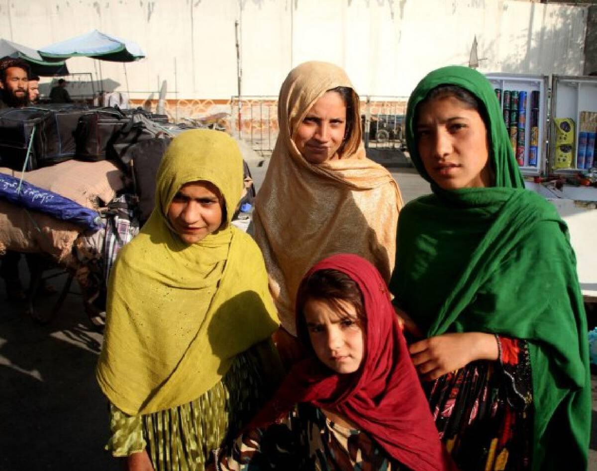Afghan girls pose for photos in Kabul, capital of Afghanistan, Sept. 15, 2021. (Photo by Saifurahman Safi/Xinhua)