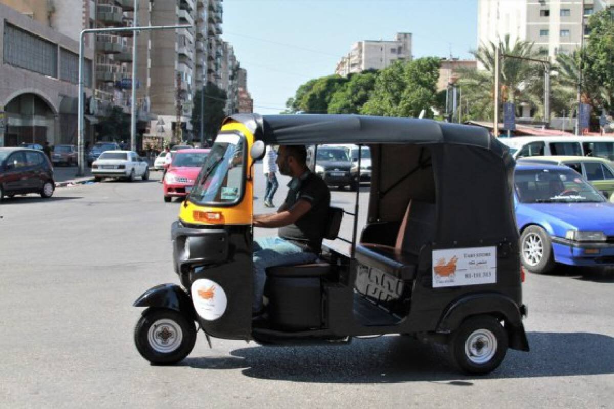 A tuk-tuk driver looks for passengers on a street in Tripoli, Lebanon, on Oct. 8, 2021. (Photo by Khaled /Xinhua)