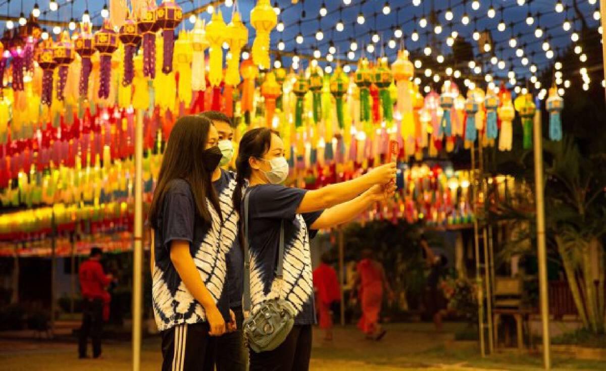 Tourists take selfies at the Wat Phra That Hariphunchai in Lamphun, Thailand, Oct. 25, 2021. (Xinhua/Wang Teng)