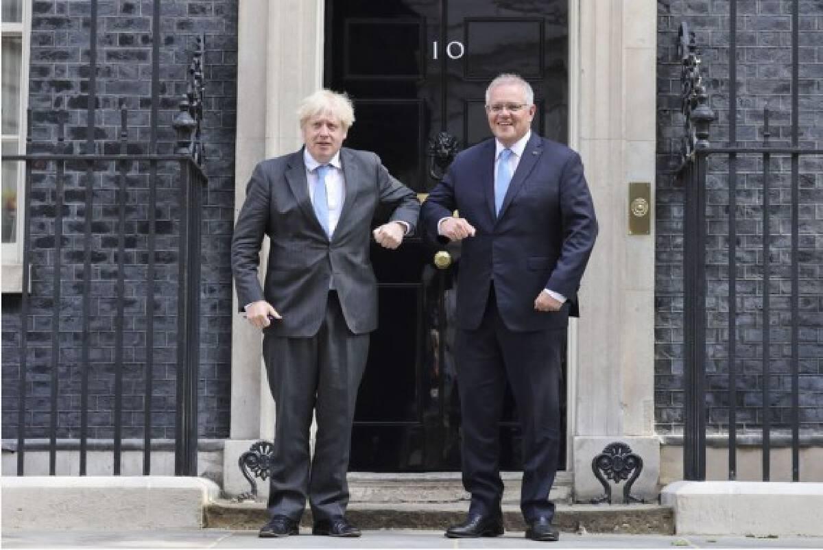 British Prime Minister Boris Johnson (L) greets Australian Prime Minister Scott Morrison in front of 10 Downing Street, in London, Britain, on June 15, 2021. (Tim Hammond/No. 10 Downing Street/Handout via Xinhua)