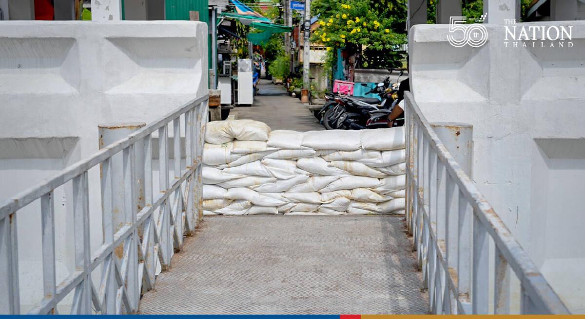 Bangkok's riverside communities warned of floods