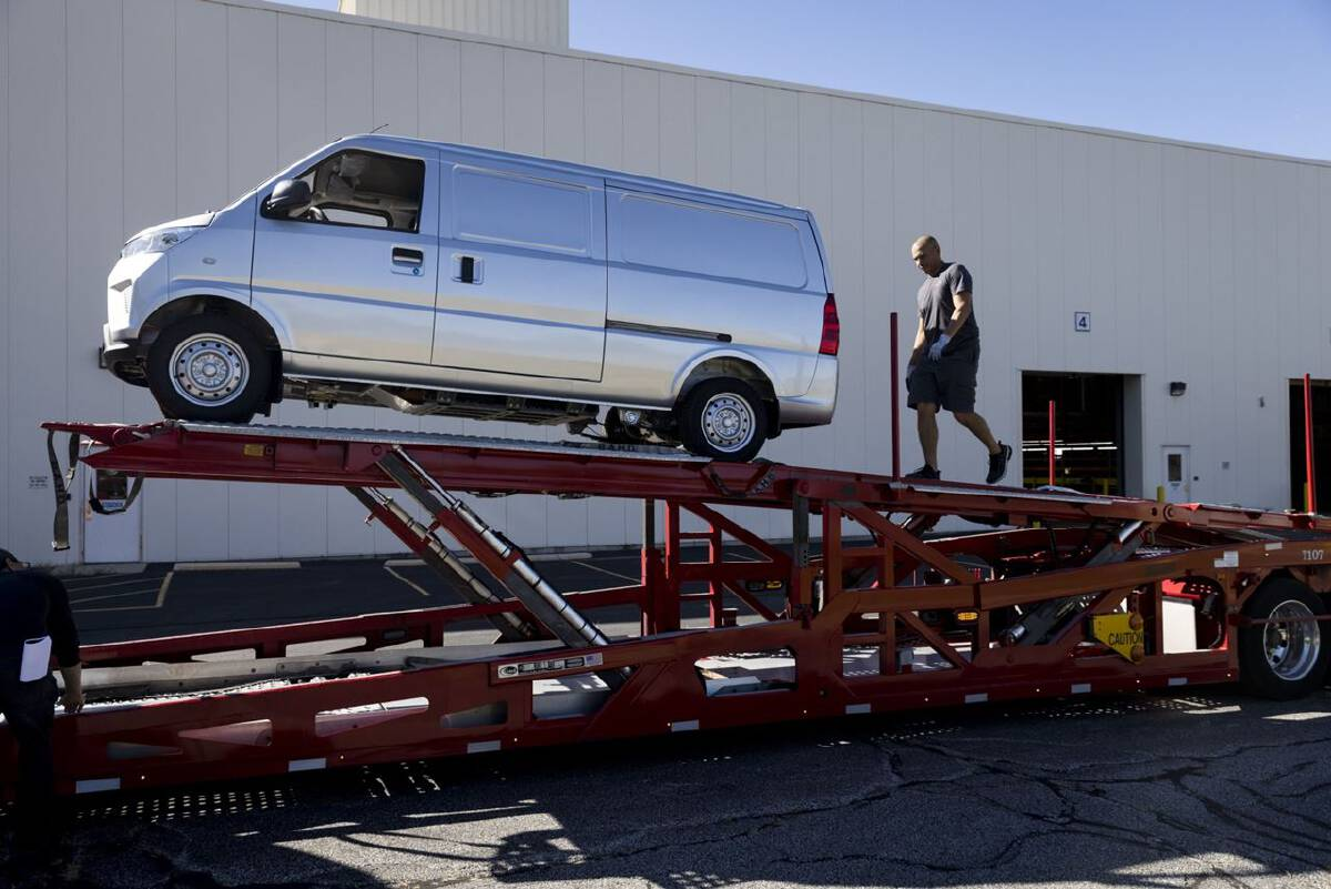 An Urban Delivery electric van is loaded onto a truck outside the Electric Last Mile Solutions facility in Mishawaka, Indiana, on Sept. 28, 2021. PHOTO CREDIT: Bloomberg photo by Taylor Glasscock.