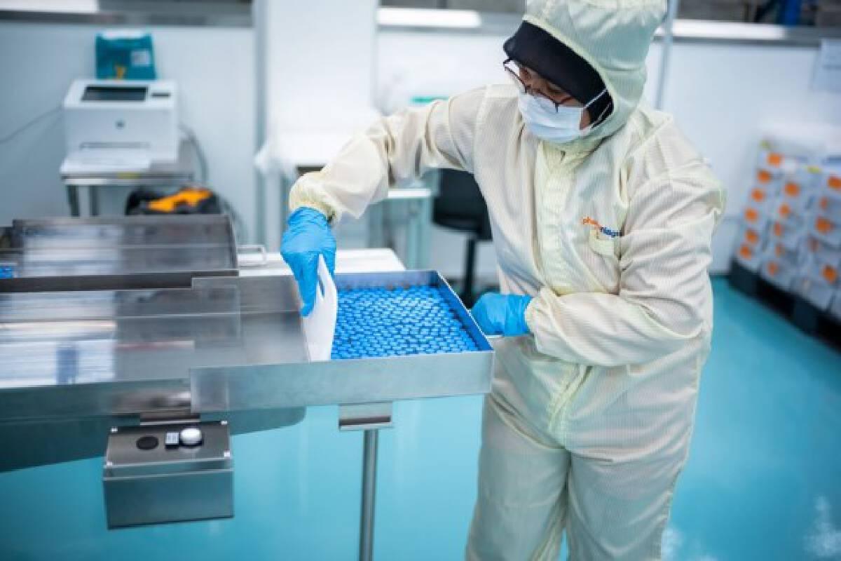 A technician works on the fill and finish operation for Sinovac vaccines at Malaysian pharmaceutical company Pharmaniaga Life Sciences (PLS) on the outskirts of Kuala Lumpur, Malaysia, Oct. 5, 2021. (Xinhua/Zhu Wei)