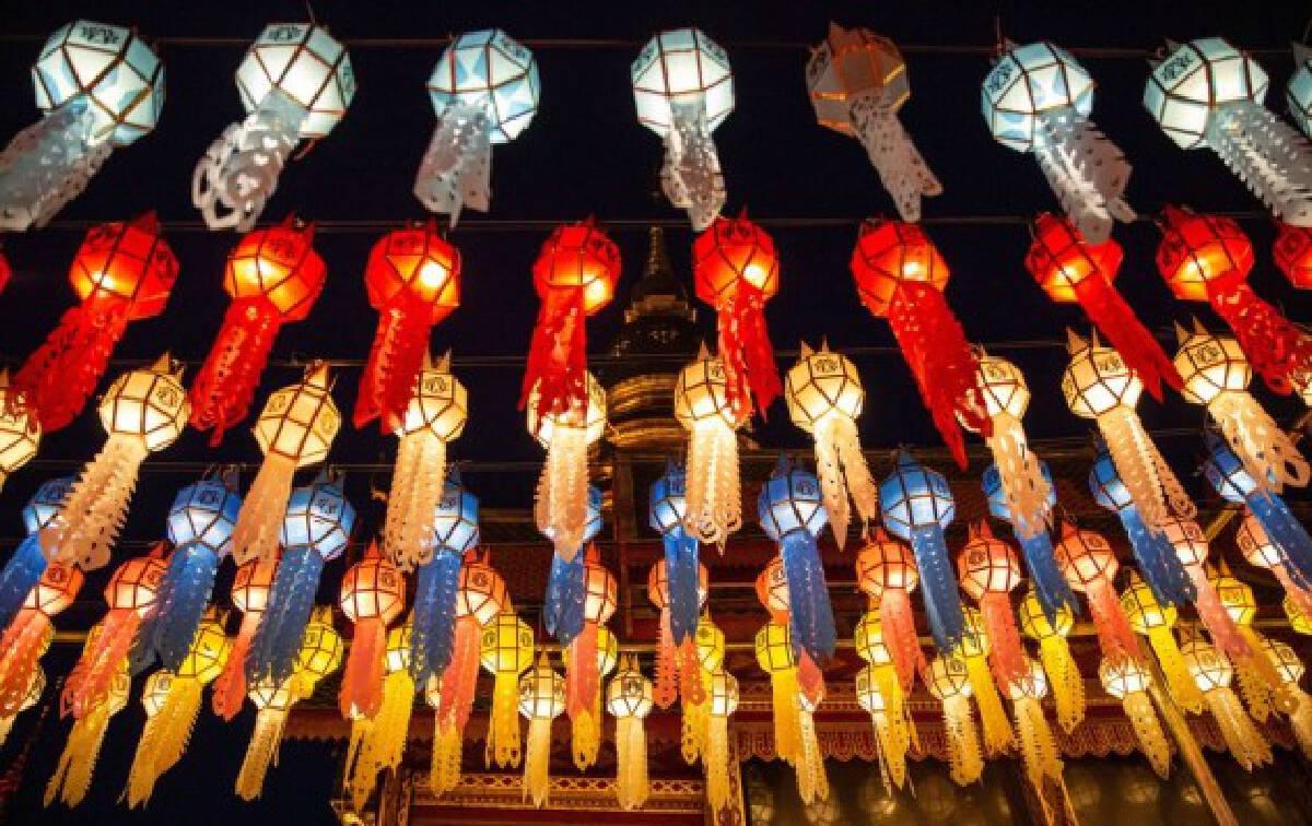 Colorful lanterns are seen at the Wat Phra That Hariphunchai in Lamphun, Thailand, Oct. 25, 2021. (Xinhua/Wang Teng)