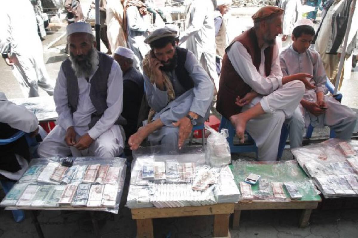 Afghan currency exchange dealers wait for customers in Kabul, capital of Afghanistan, Sept. 4, 2021. (Photo by Saifurahman Safi/Xinhua)