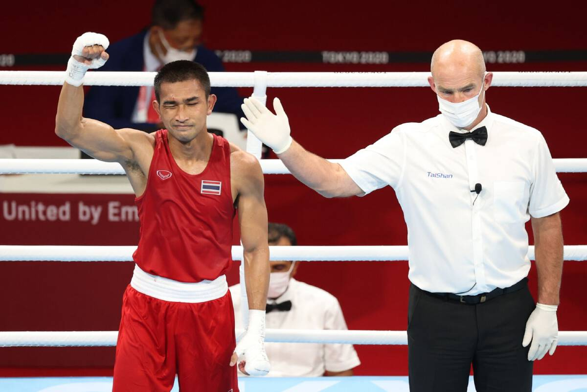 Thailands Chatchai-Decha one win away from boxing medal at Tokyo Olympics.